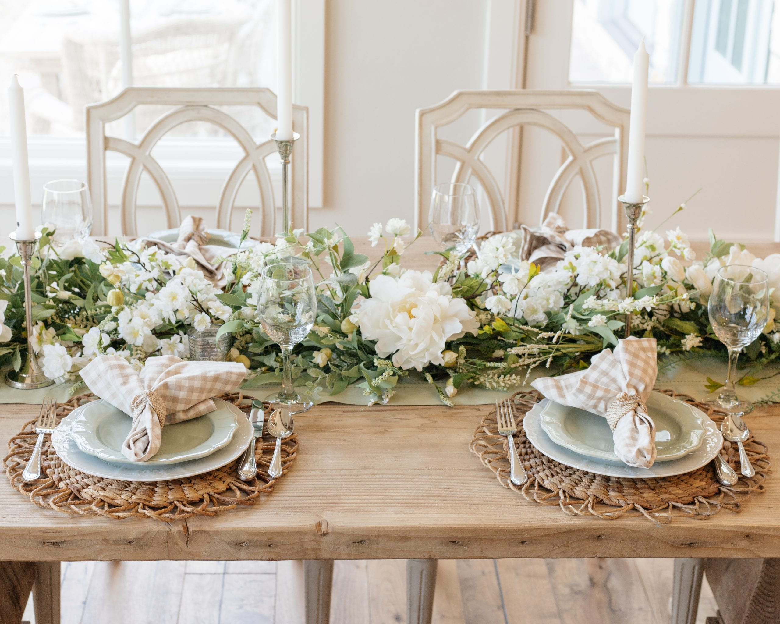 sage green and white place setting