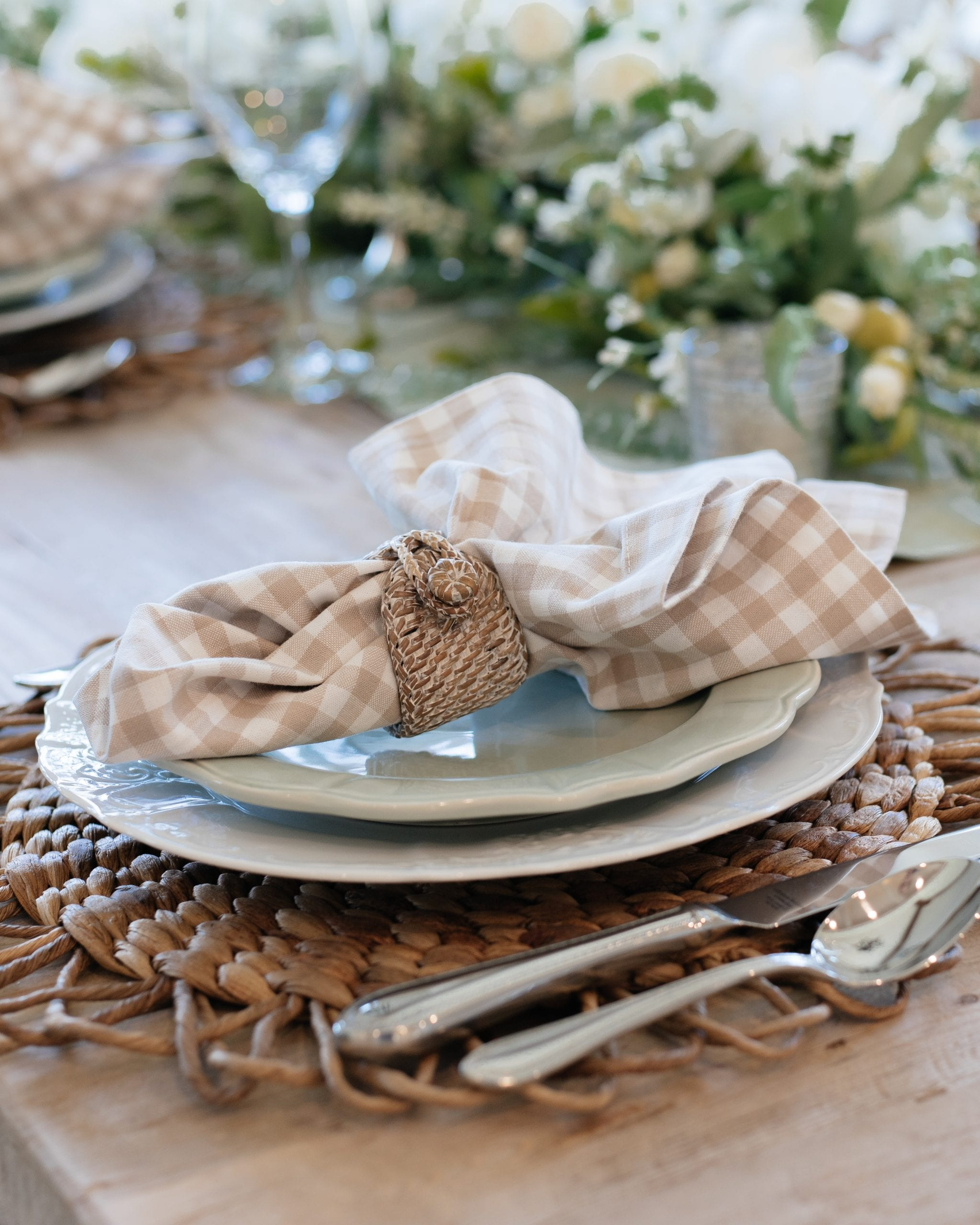 sage green and white indoor place-setting