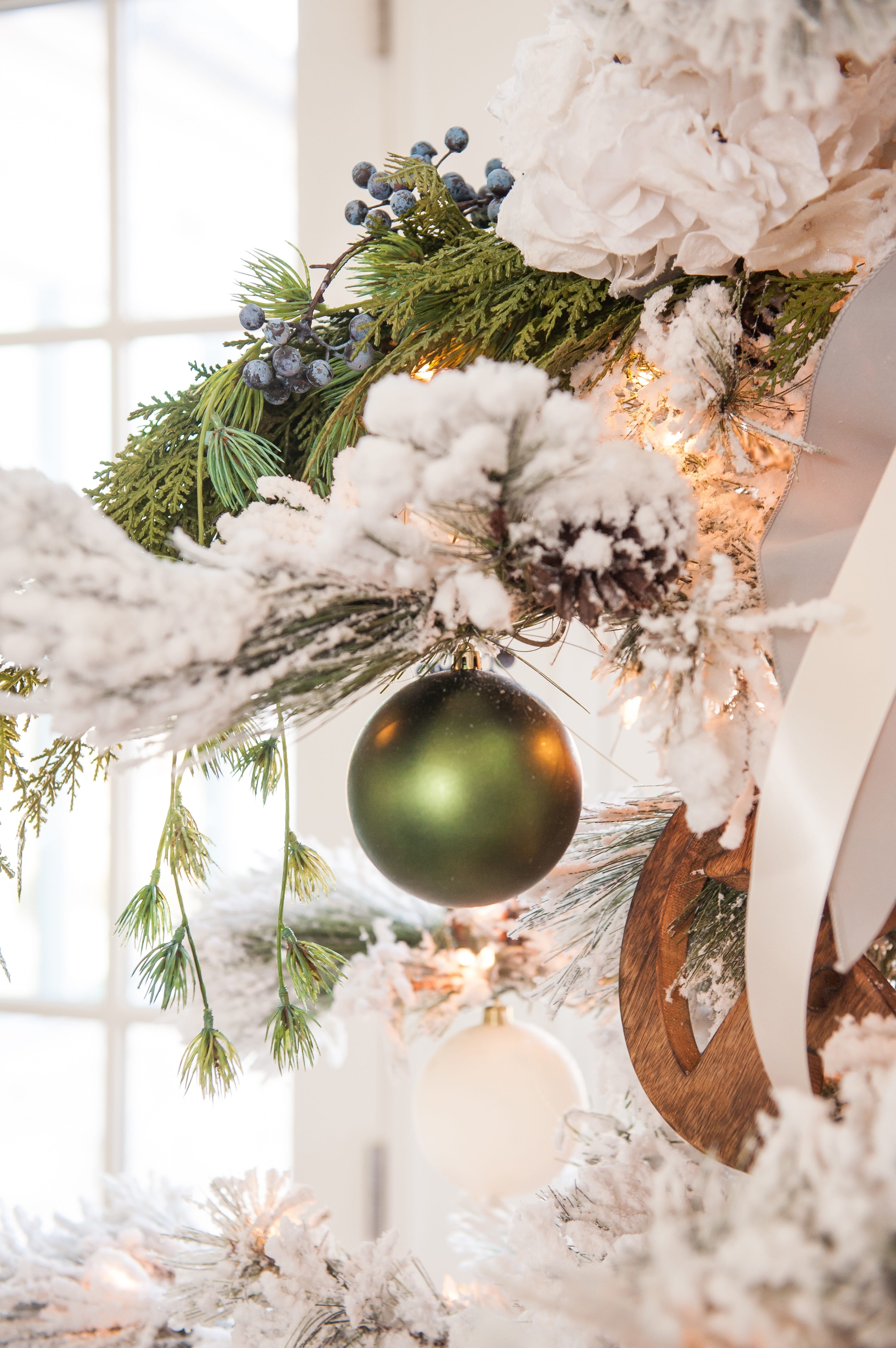 Christmas tree flocked long needle pine christmas tree flocked tree blue decor blue christmas ornaments trimming the tree shades of blue on white blue and cream flocked long needle pine artificial tree blue white ivory cream silver ornaments plaid ribbon