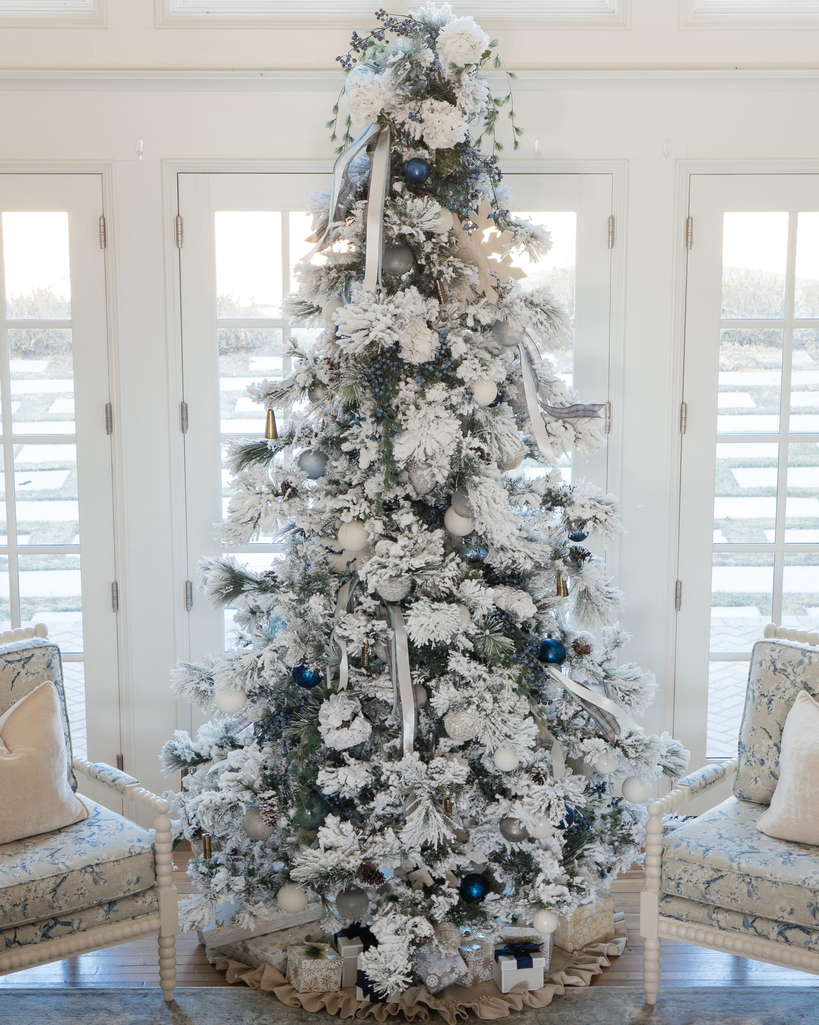 Christmas tree flocked long needle pine christmas tree flocked tree blue decor blue christmas ornaments trimming the tree shades of blue on white blue and cream