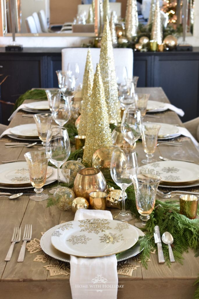 gold and silver table setting tablescape holiday table setting dinner table place setting snowflake christmas decor entertaining christmas parties
