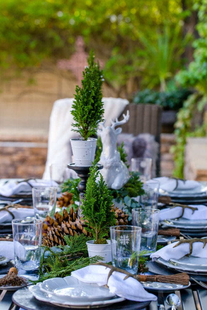 white winter tablescape table setting place setting brunch table decor entertaining hosting at home holidays christmas centerpiece greenery lenox white dinnerware snowflakes