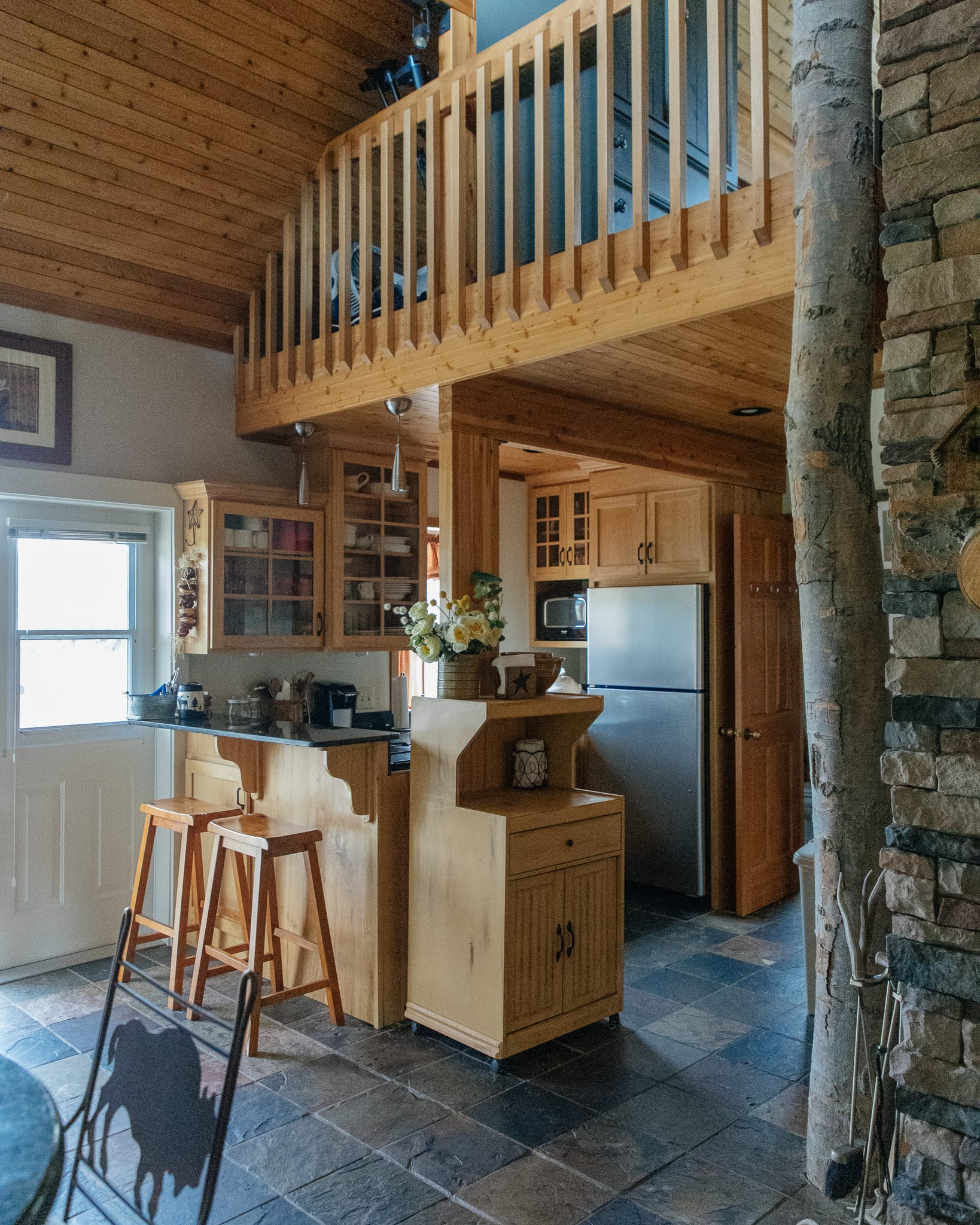 Montana cabin home tour kitchen and entryway fireplace
