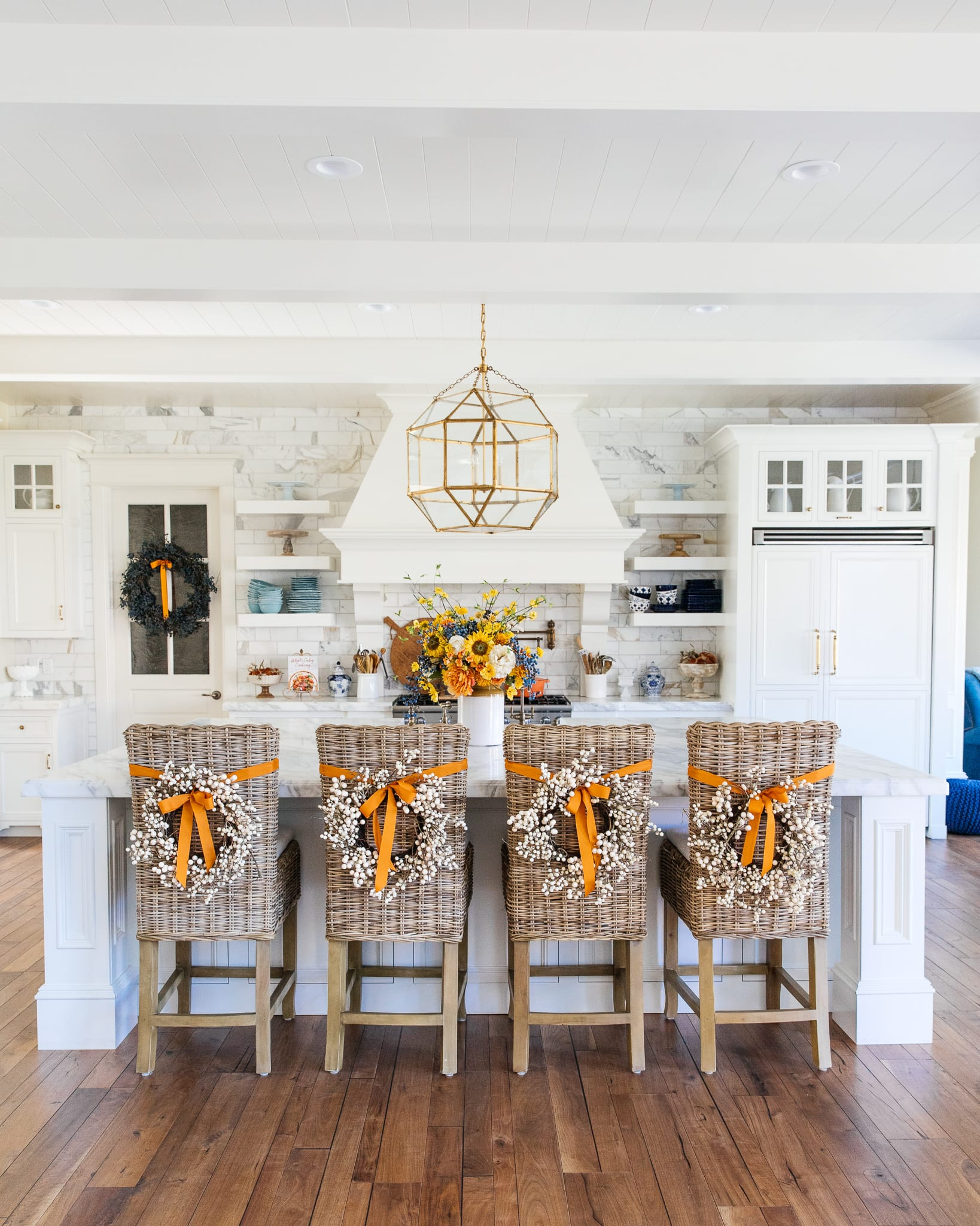barstools with berry wreaths white kitchen