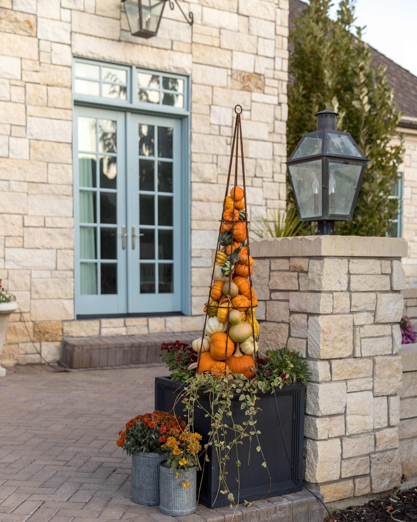 fall front porch decor pumpkin tower obelisks