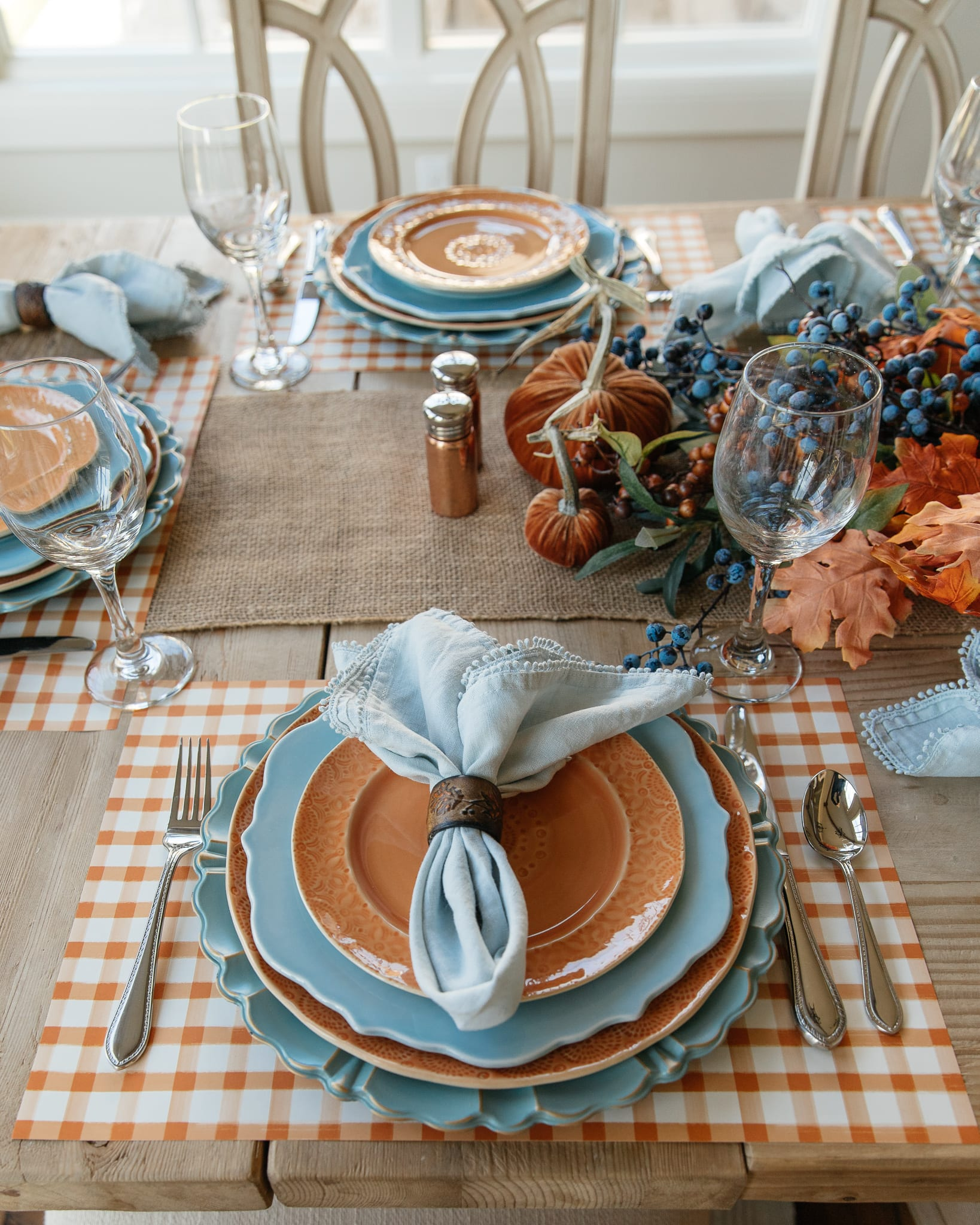 place-setting blue and orange pumpkin tablescape
