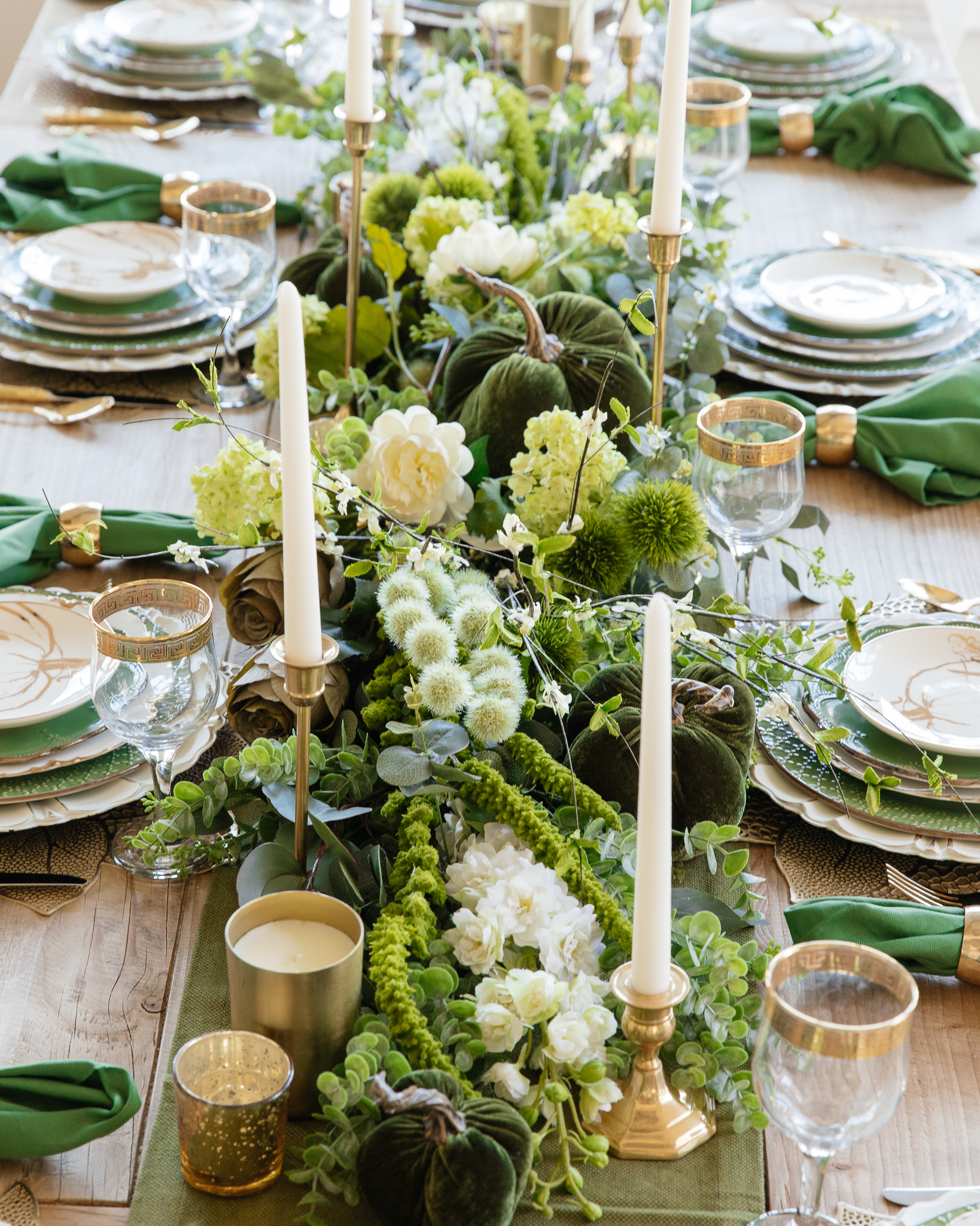 faux flowers layered into garland centerpiece