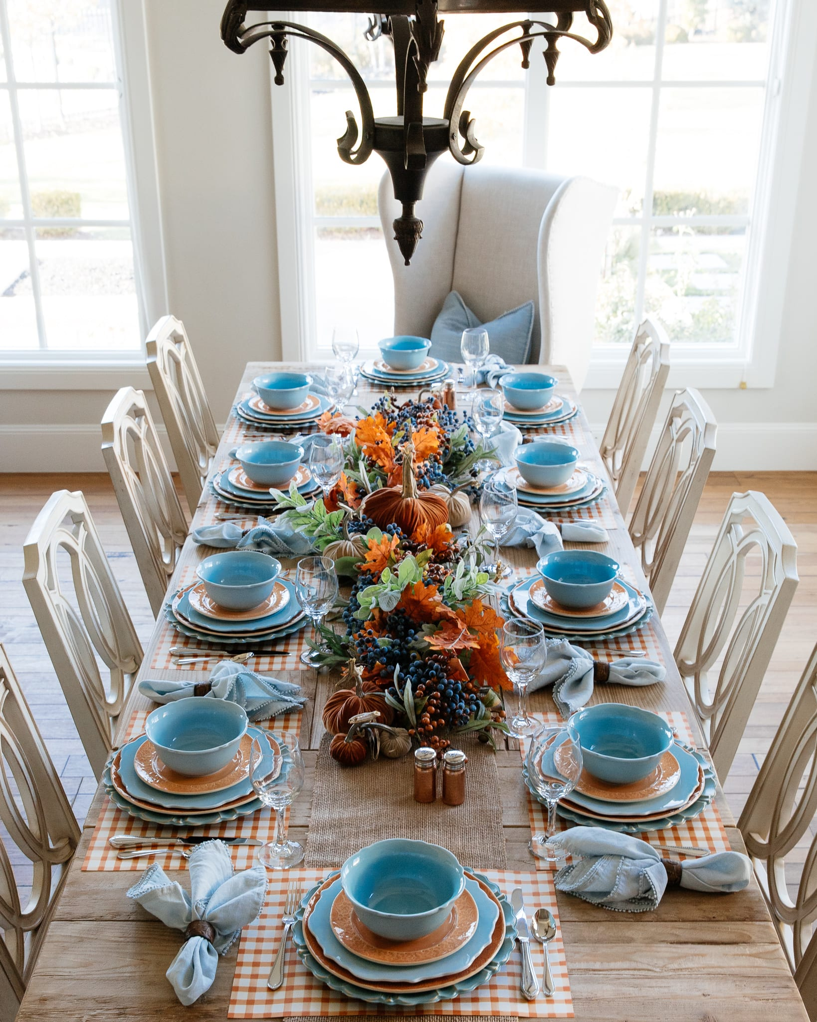 fall pumpkin themed blue and orange tablescape