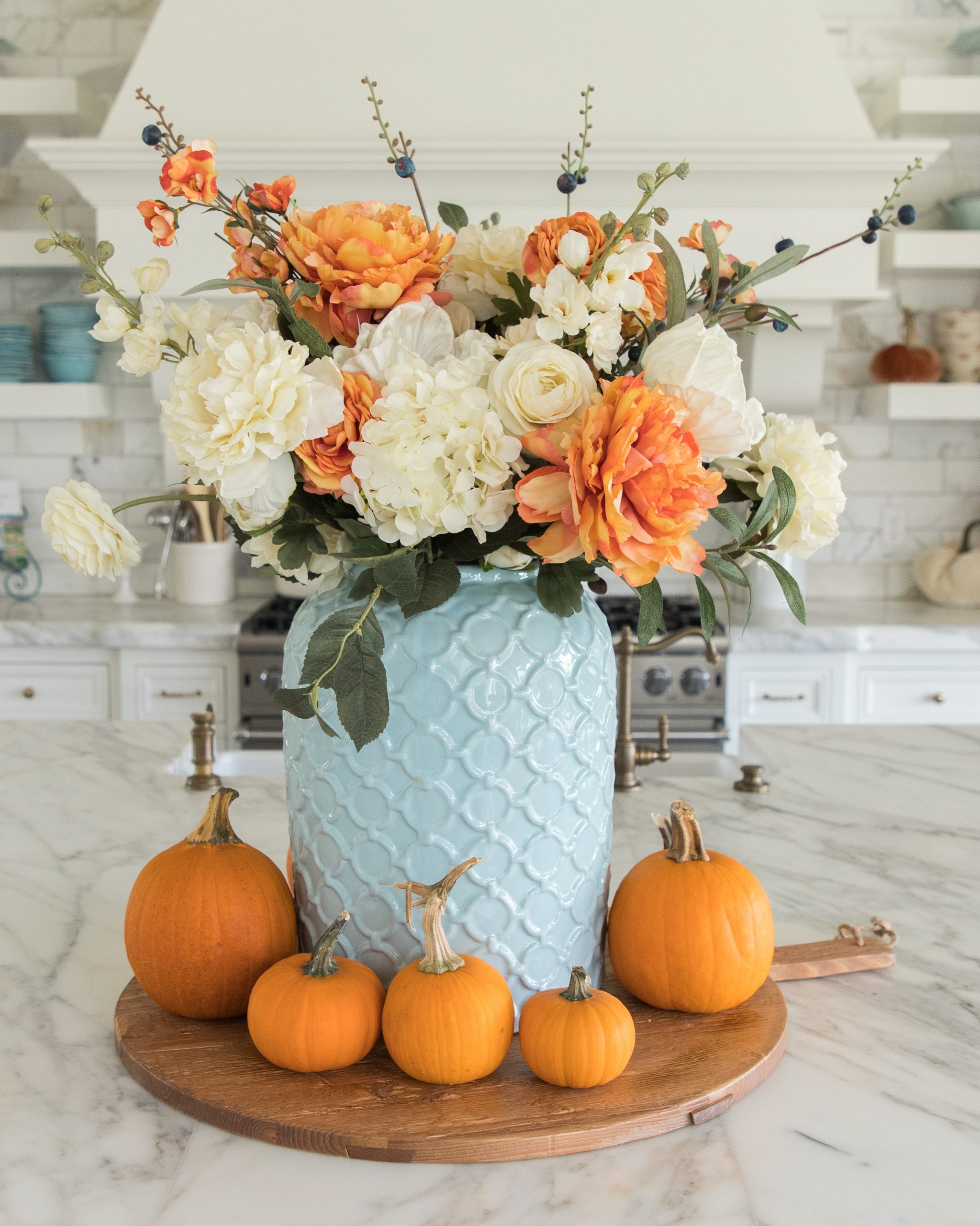 light blue and orange faux flower centerpiece