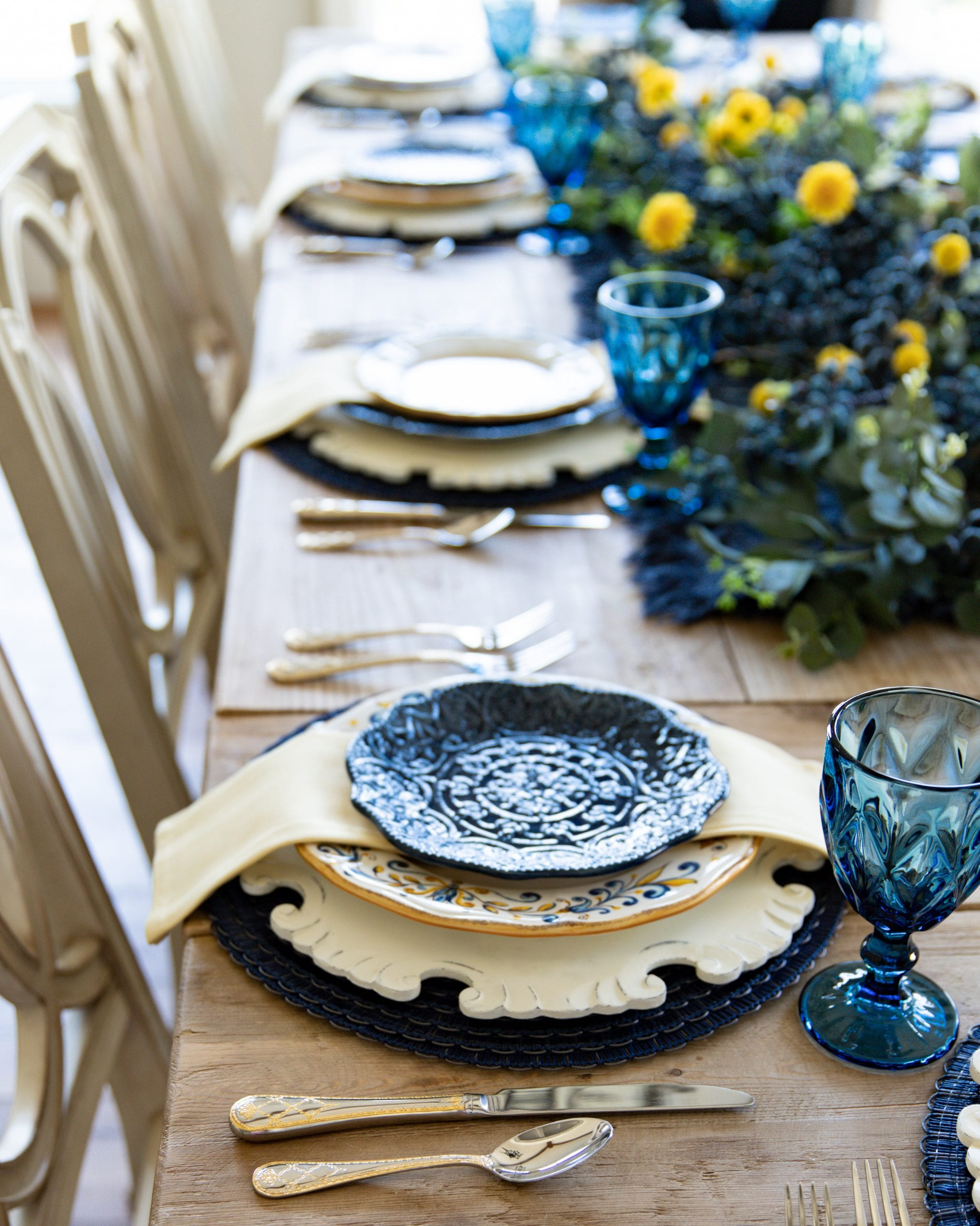 blue and yellow place-settings dinner plates