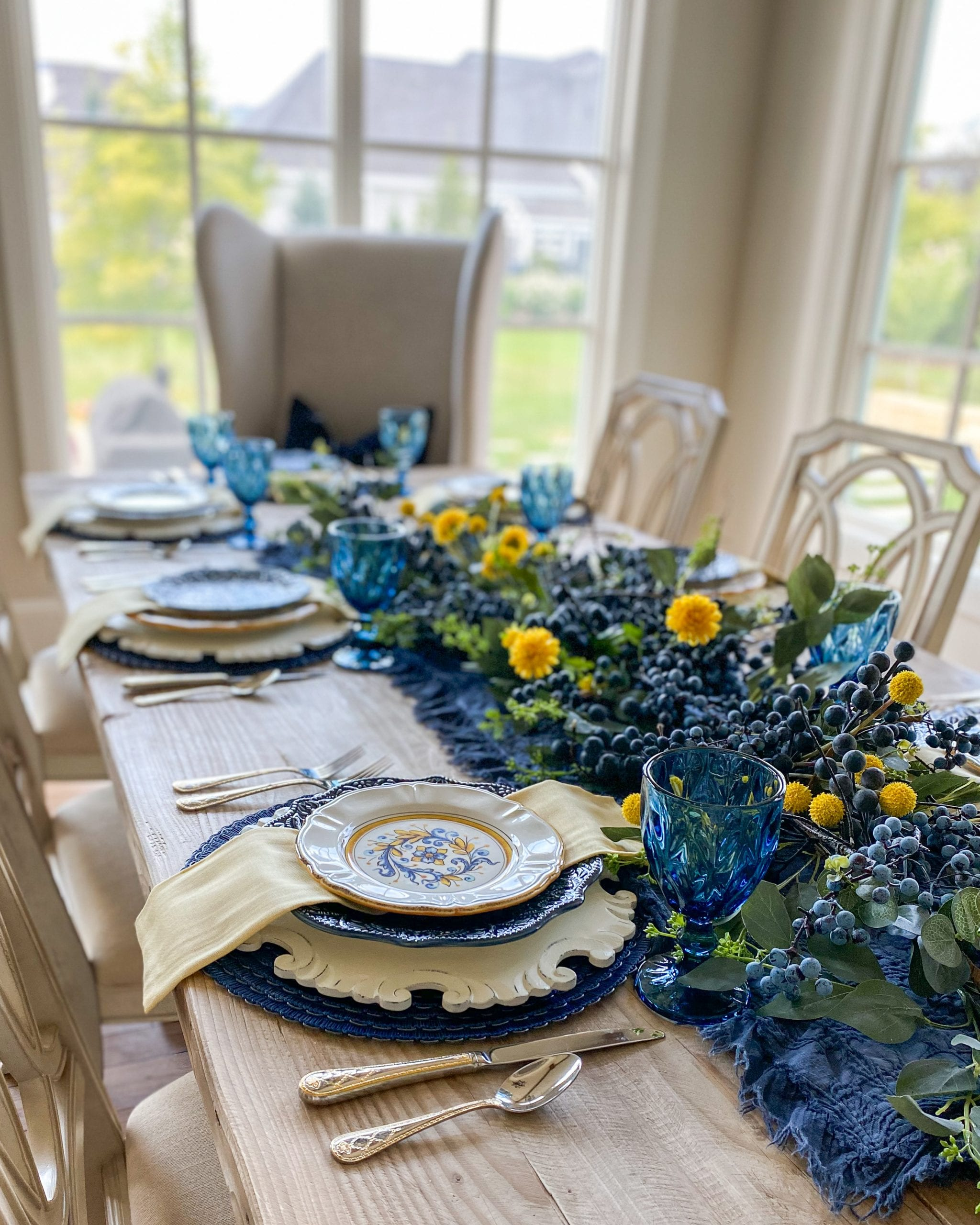 blue and yellow dining tablescape