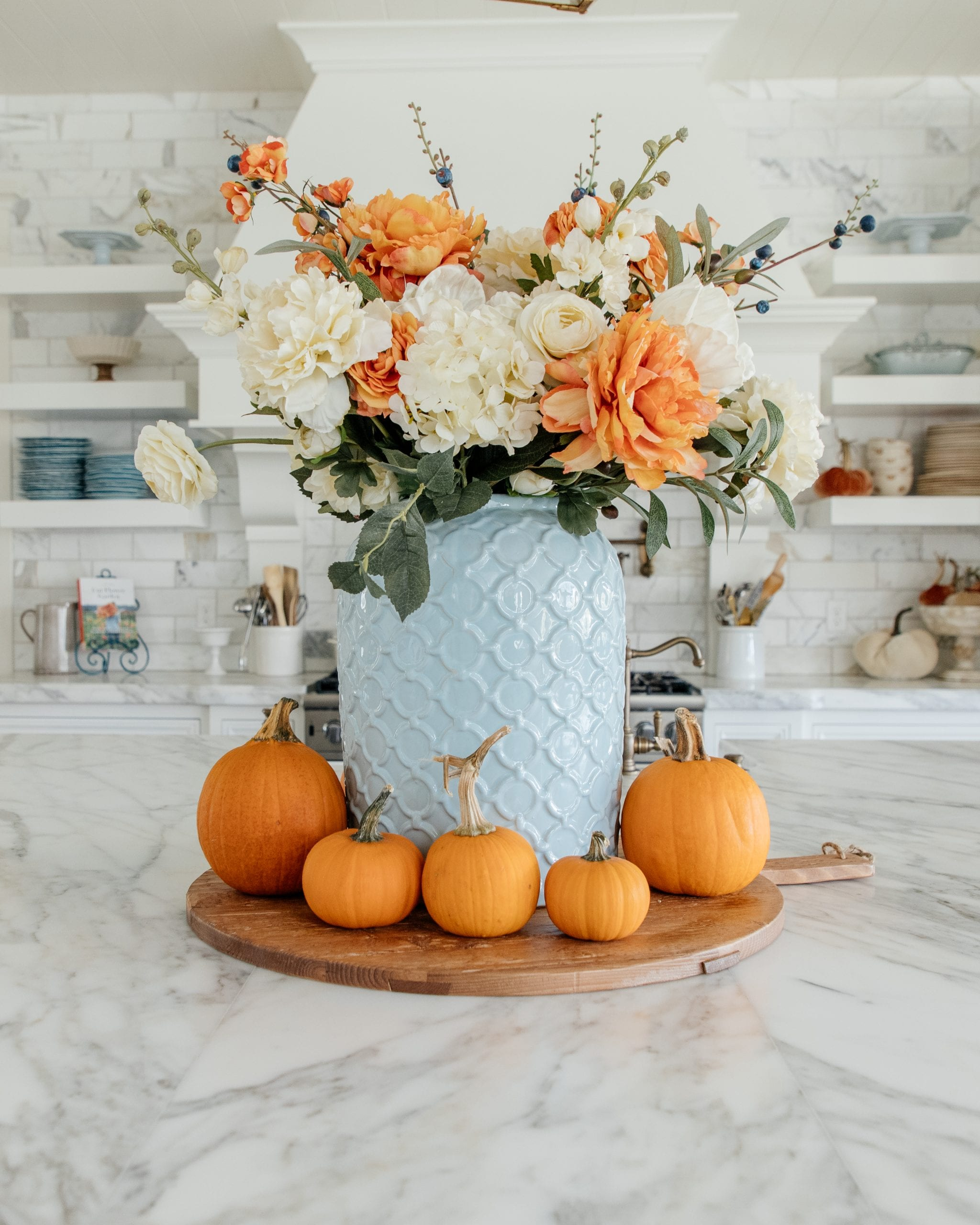 blue orange faux flower centerpiece