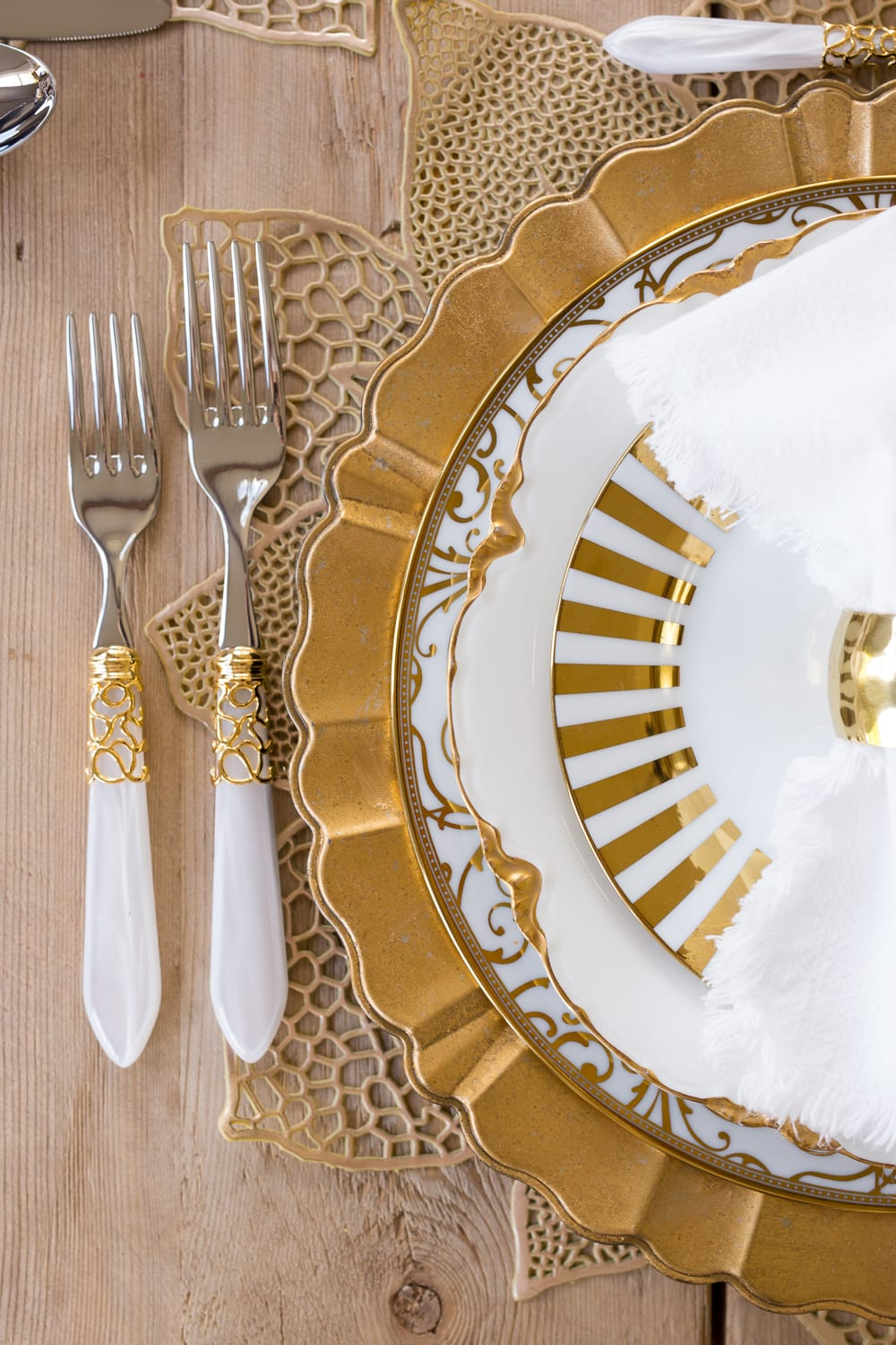 gold and white flatware