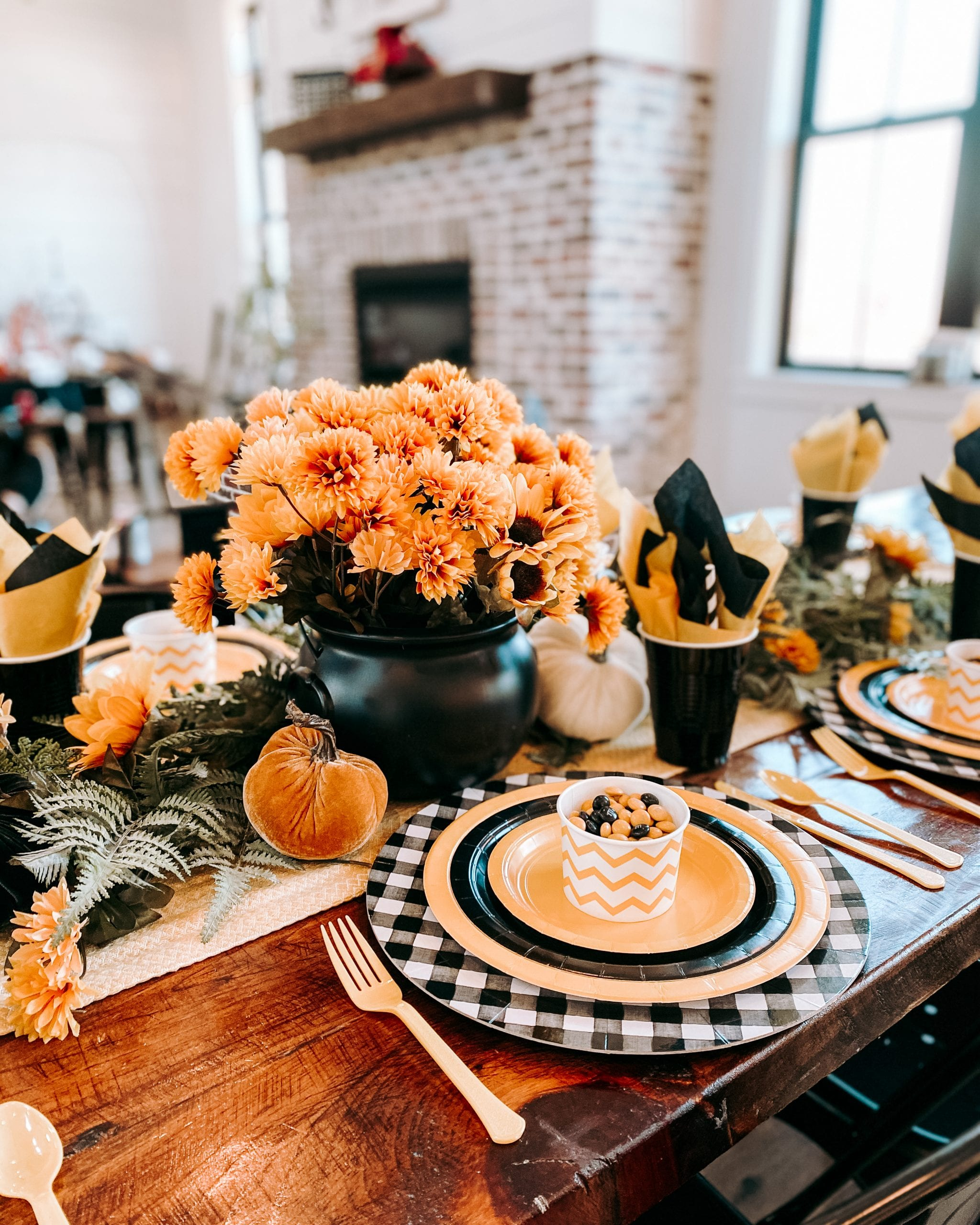 black and yellow paper plate party table