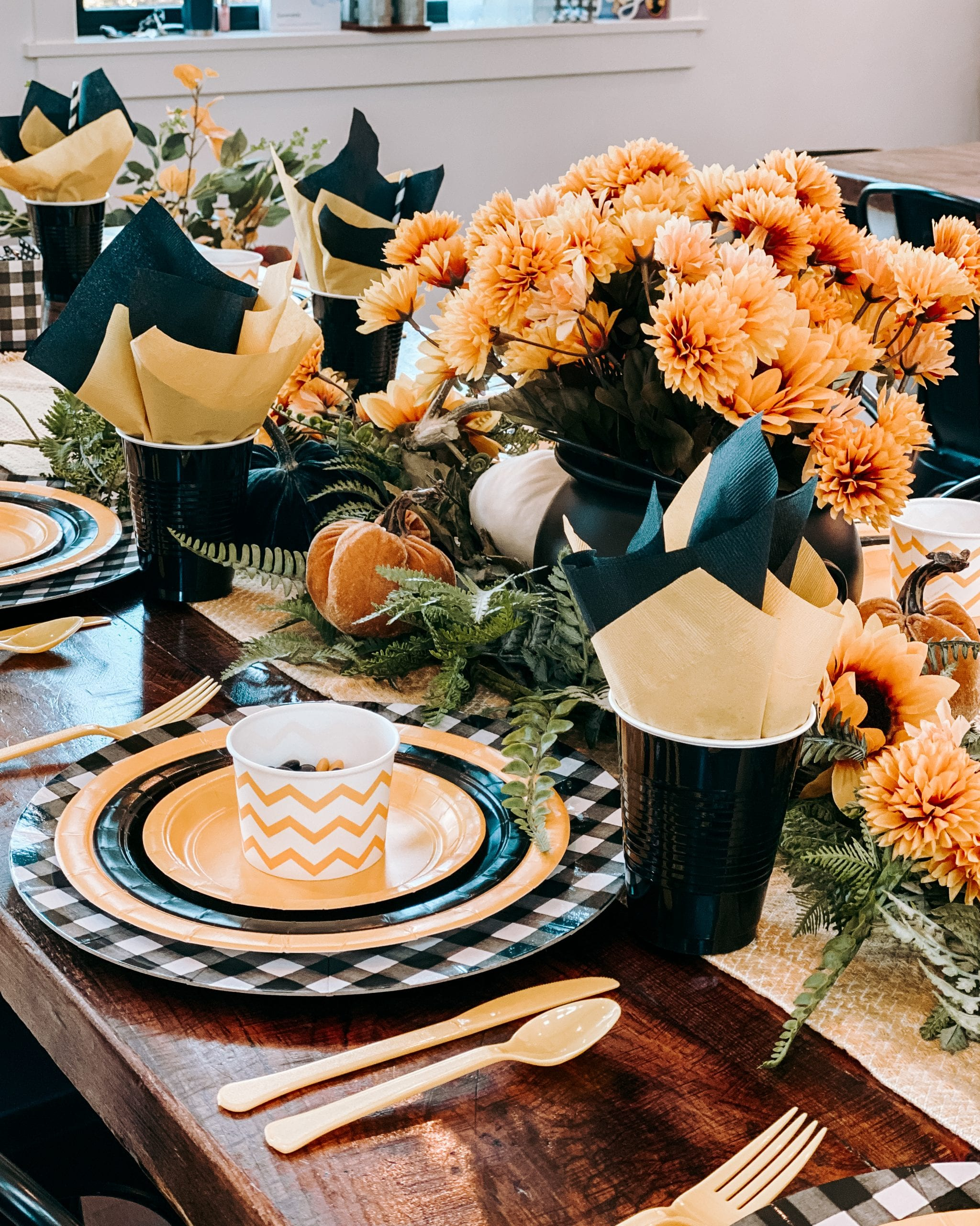 black and yellow paper plate table setting