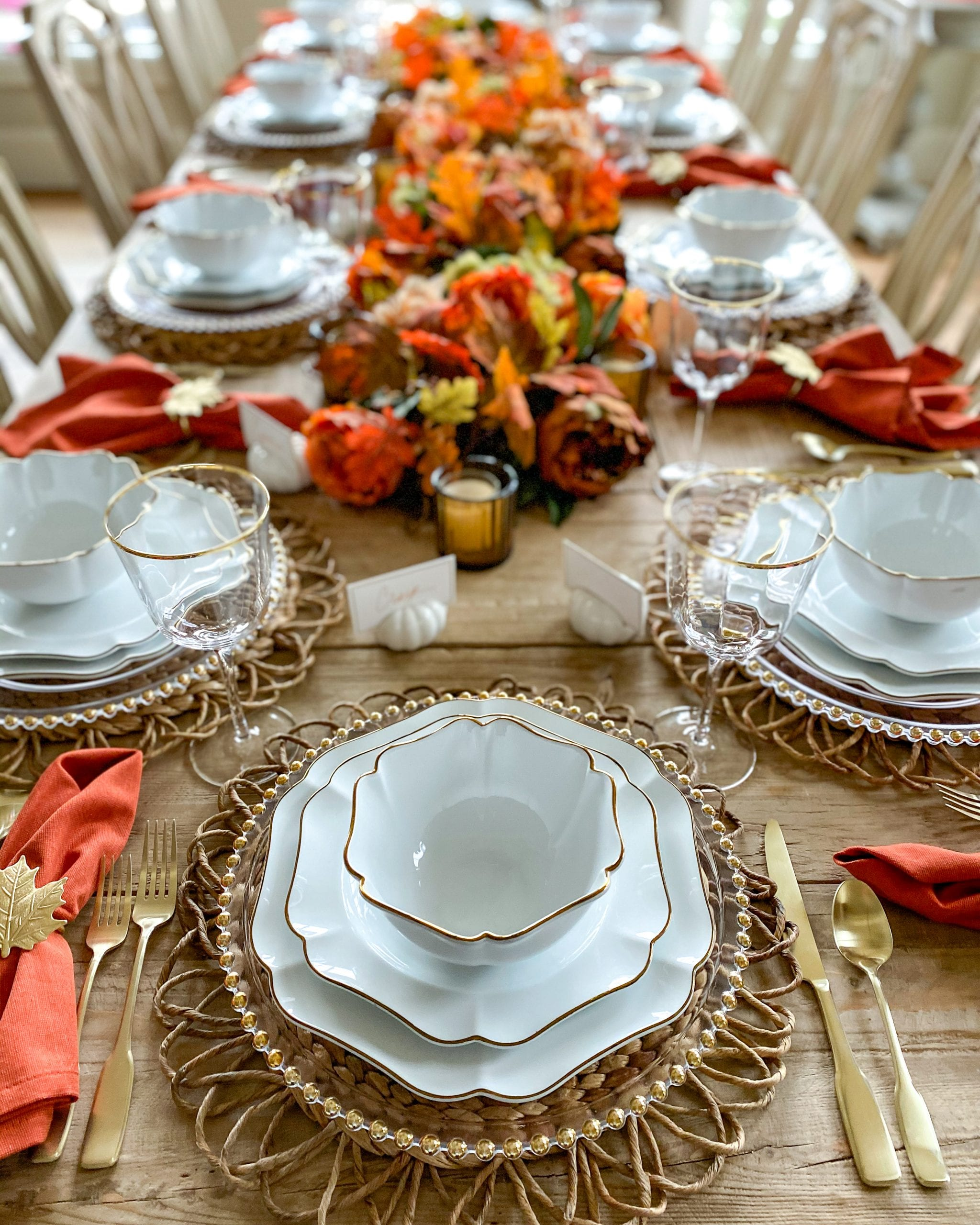 gold and white dinnerware table setting