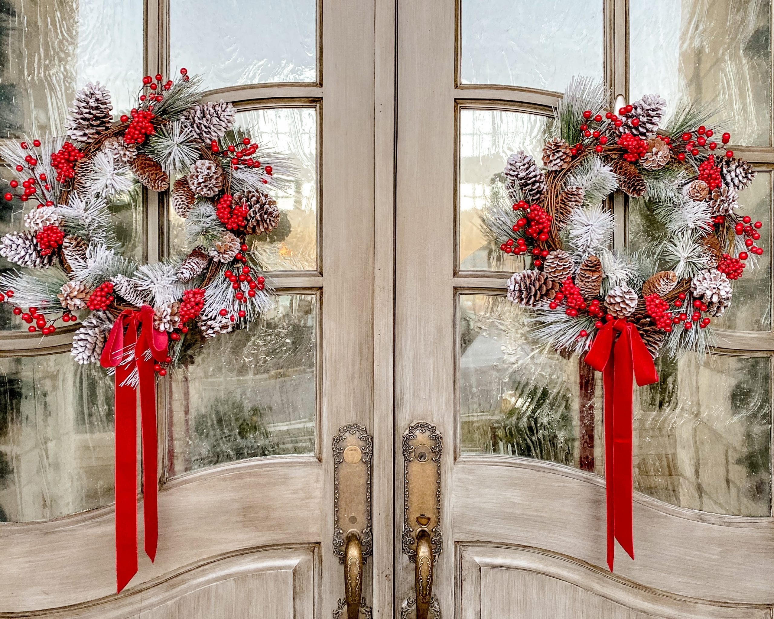red and white flocked christmas door wreaths
