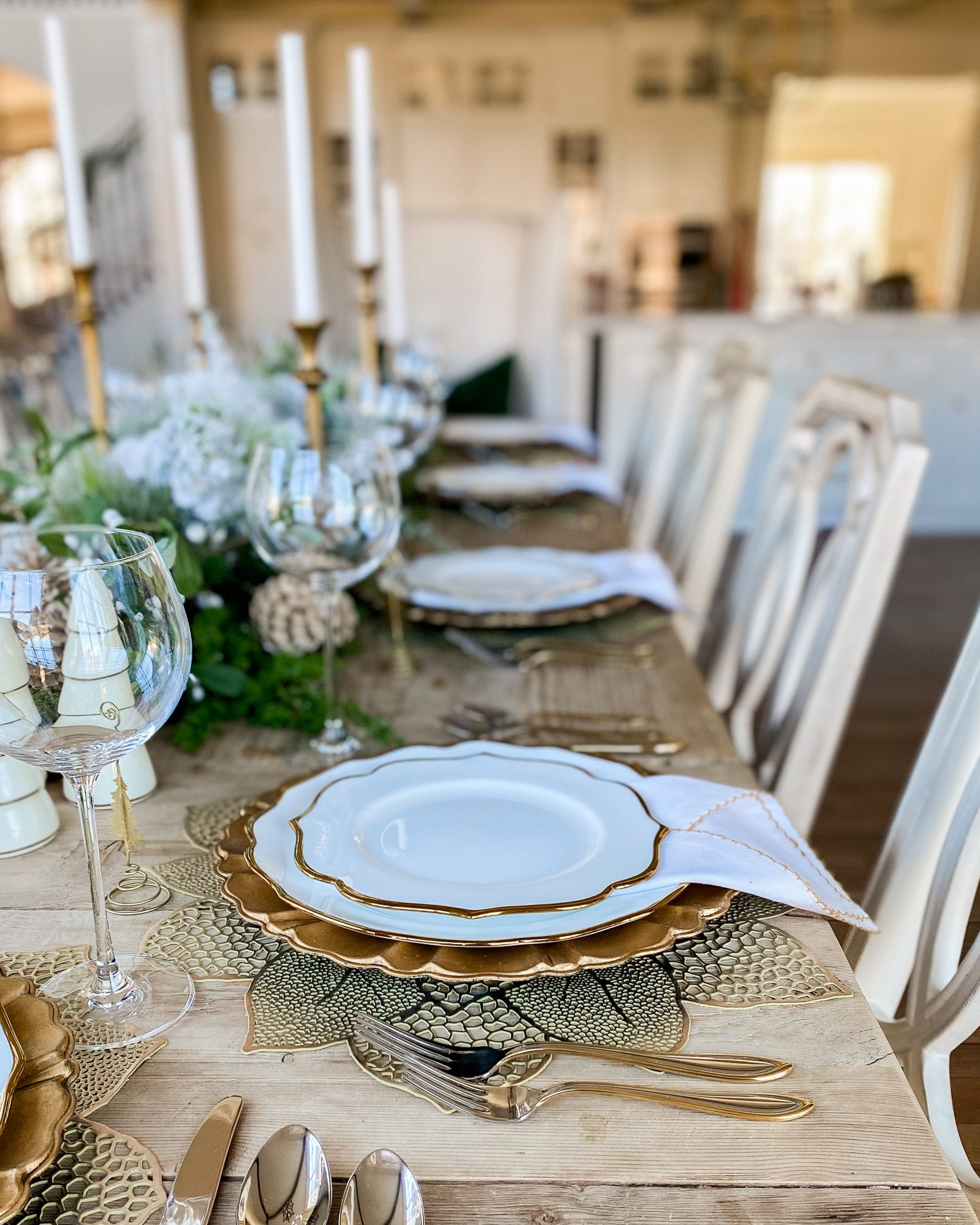 gold and white scalloped dishes