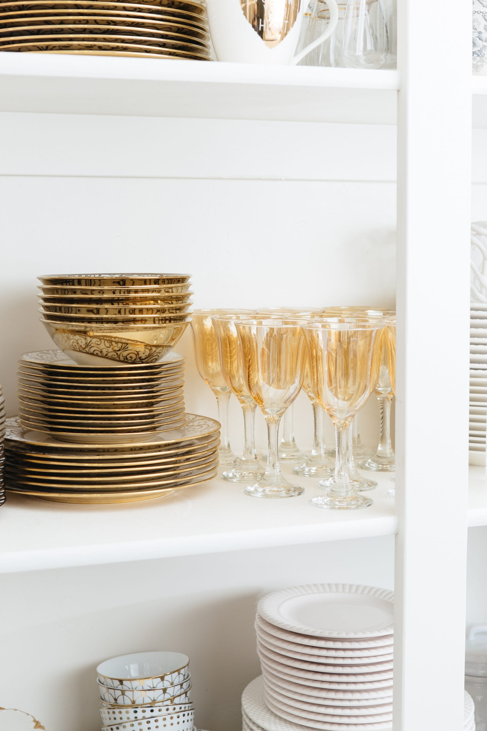 gold and white dishes